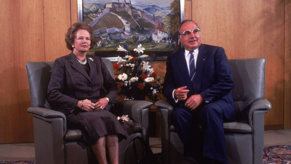 Polite smiles at a formal meeting of Margaret Thatcher and Helmut Kohl in 1986. The Iron Lady learned to live with German reunification but remained very suspicious of Germans.