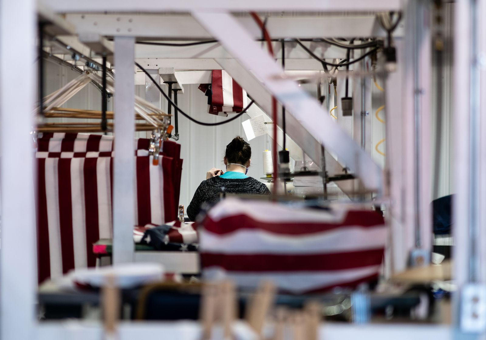 An Amish worker sews fluid-resistant gowns at Stitches USA in Walnut Creek, Ohio, on April 3, 2020. (Erin Schaff/The New York Times)