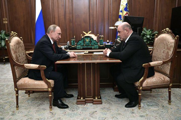 Wladimir Putin und Michail Mischustin: erster Besuch beim Präsidenten