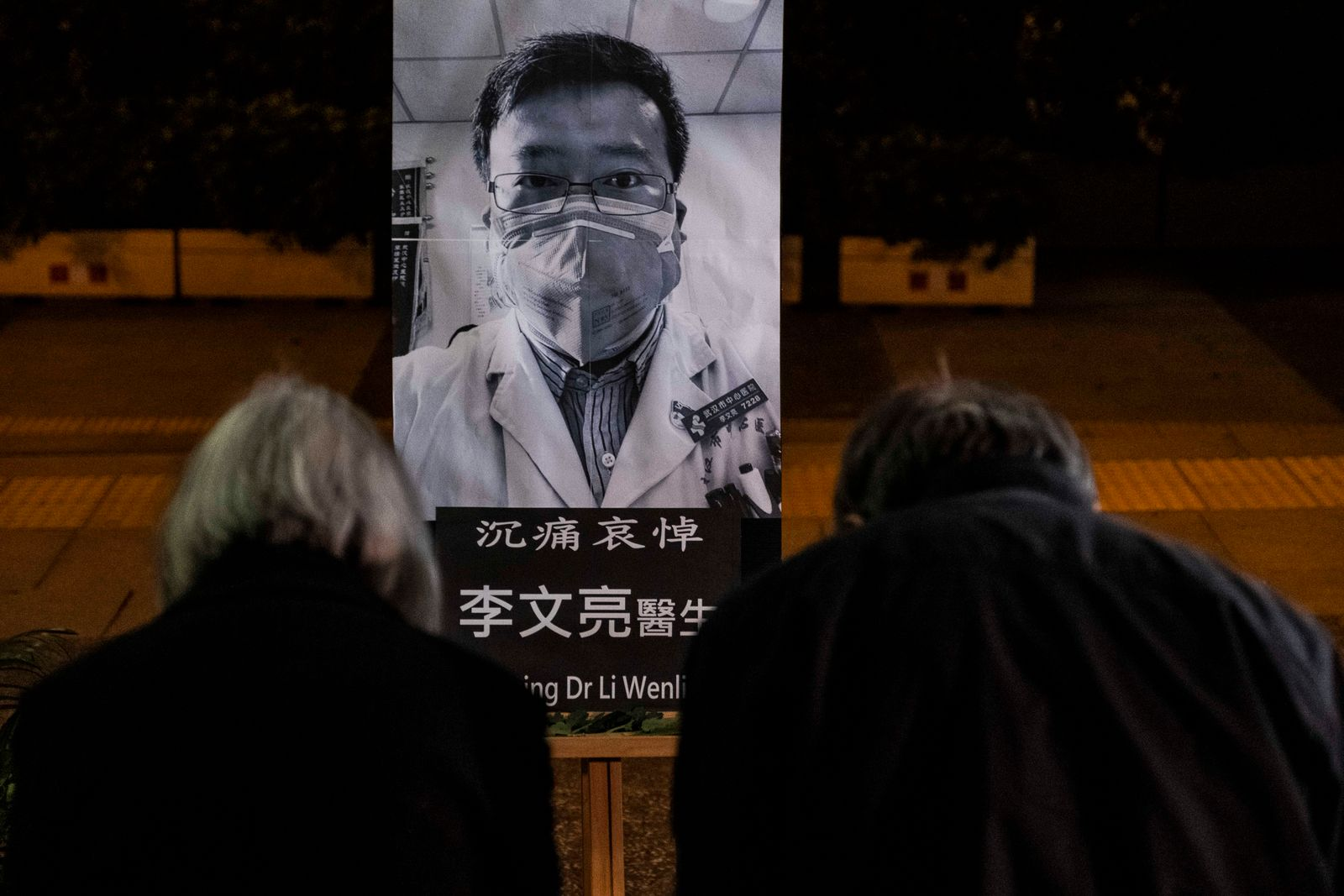 People pay respects at a memorial to Li Wenliang, who was silenced by police for being one of the first to warn about the coronavirus, in Hong Kong, Feb. 7, 2020. (Lam Yik Fei/The New York Times)