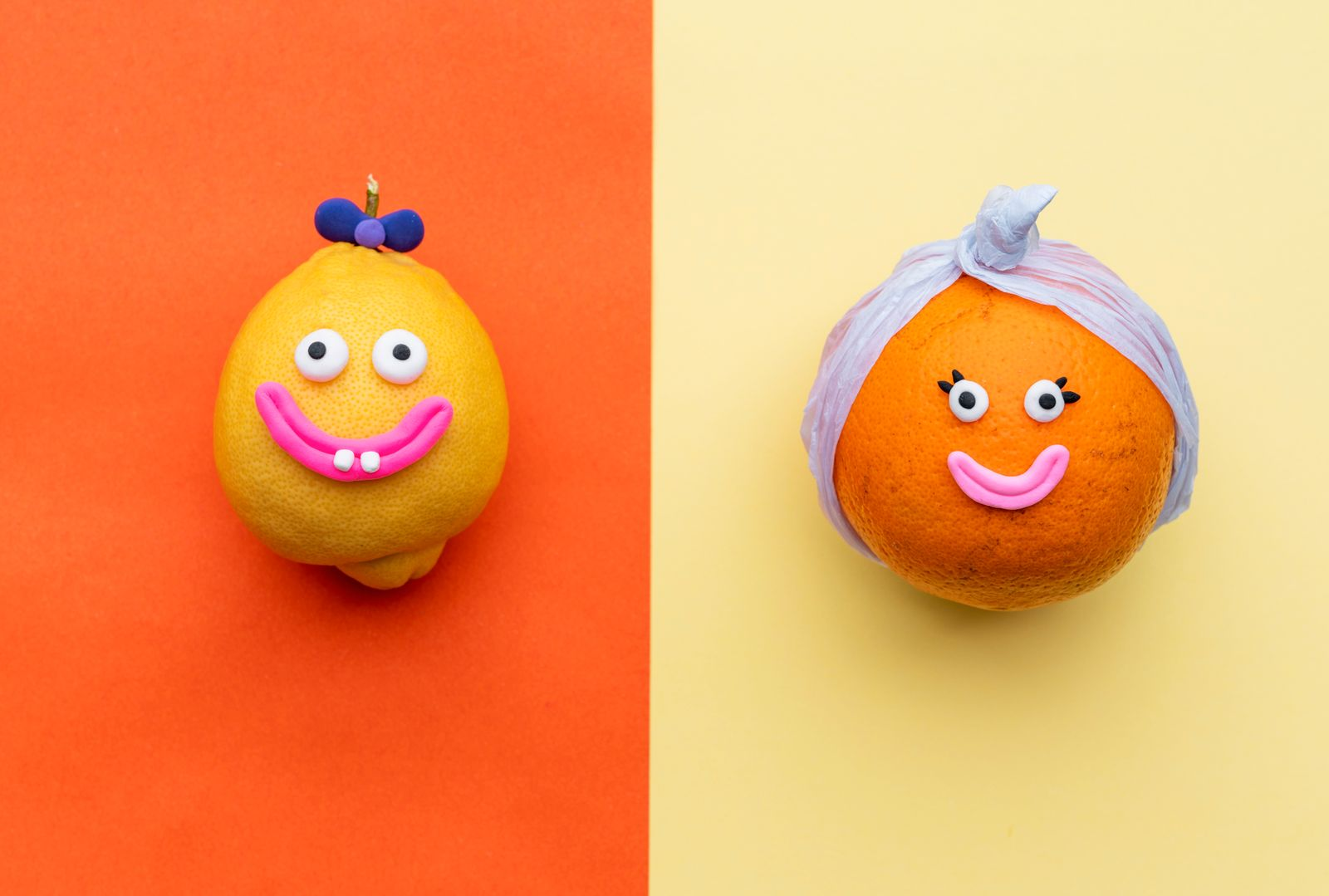 Happy orange fruit with face and paper turban and funny lemon with a bow smiling