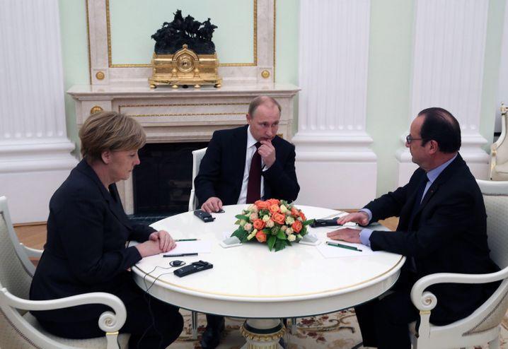 Im Kreml am 6. Februar: Kanzlerin Merkel, Russlands Präsident Putin und Frankreichs Präsident Hollande