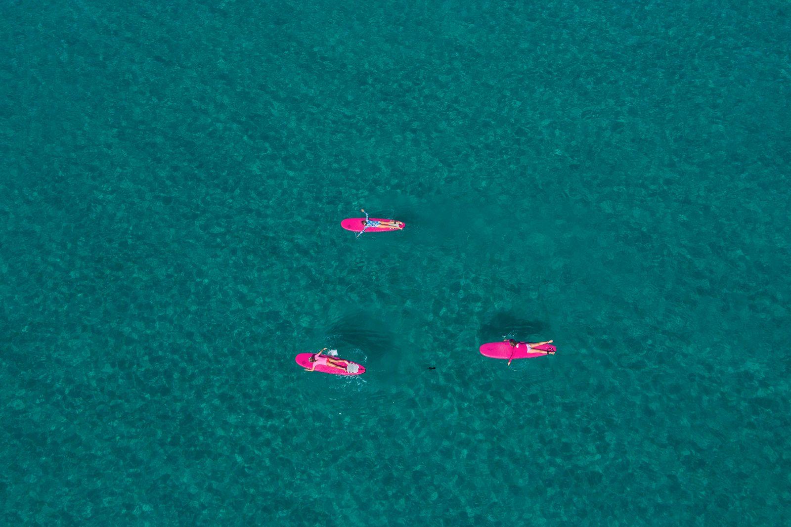 June 24, 2020, Jupiter, Florida, U.S: Kids float on their surfboards during the Blue Water School of Surfing Summer Cam