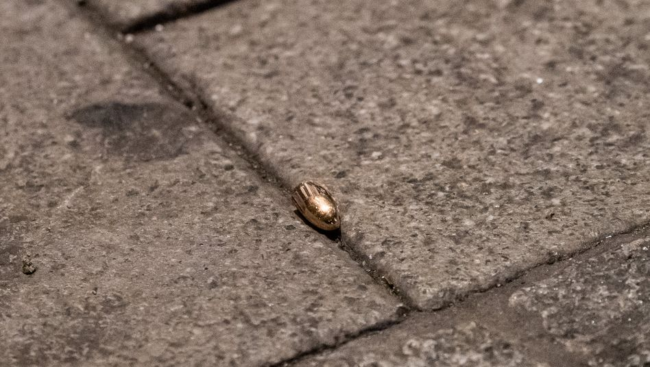 A bullet on the ground at the scene of the crime in Hanau, Germany