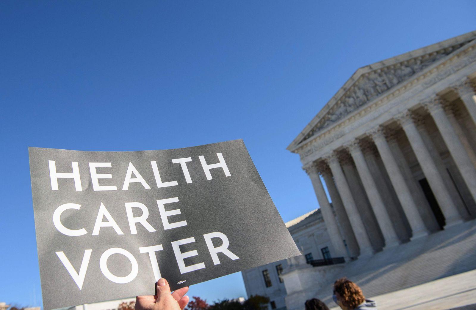 FILES-US-JUSTICE-HEALTH-OBAMACARE