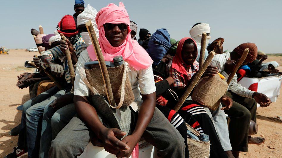 Migrants preparing to travel north into Libya.