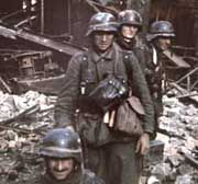 The Battle of Stalingrad: German infrantry soldiers march through the rubble.