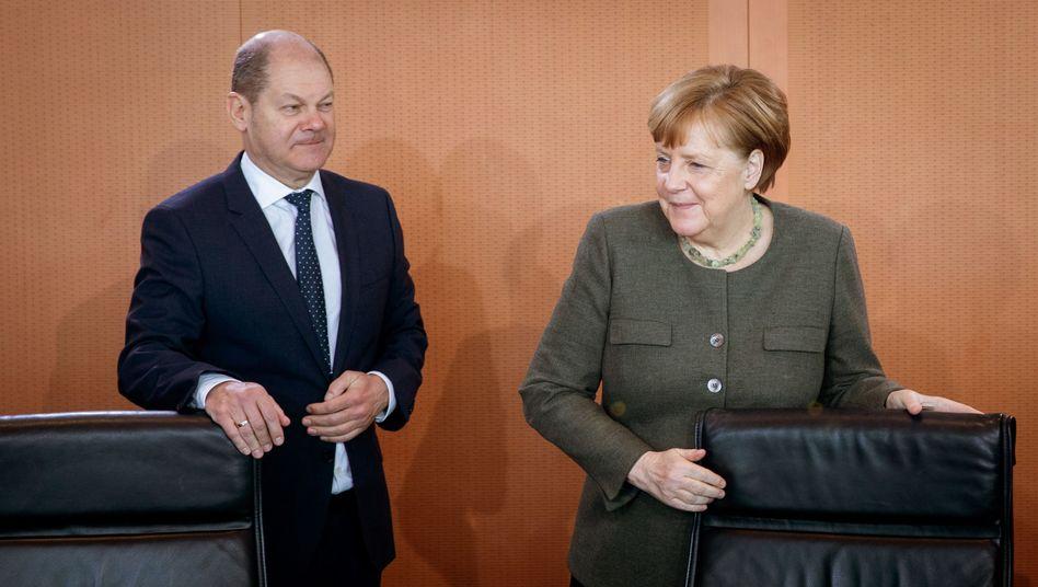 Bundeskanzlerin Merkel, Finanzminister Scholz: Einigung gefordert