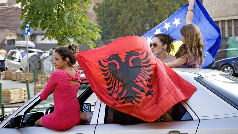Kosovo Albanians celebrate in the divided town of Mitrovica in 2010 after the International Court of Justice ruled on the legality of Kosovo's independence. Despite EU efforts, the country remains dominated by drugs, clans and corruption.