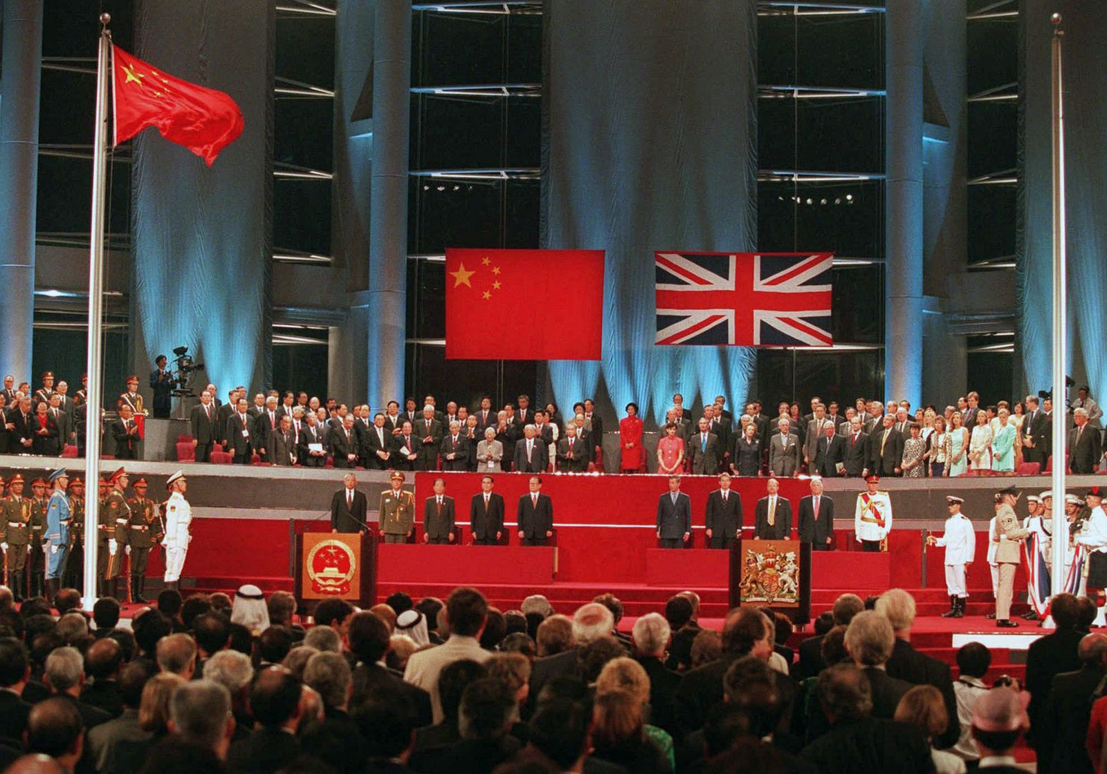CHINESE FLAG FLIES UNION JACK LOWERED