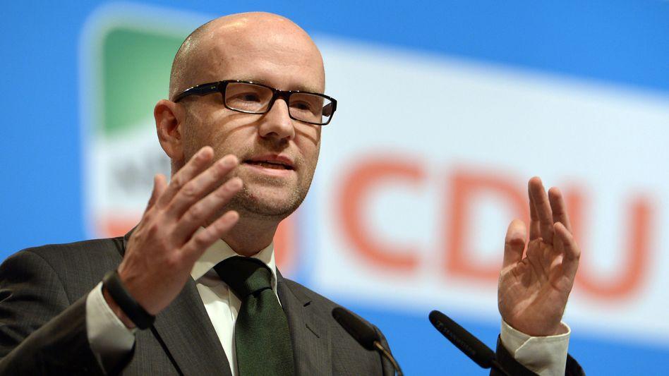 """CDU-Generalsekretär Tauber (April 2014): """"Arschloch""""-Bezeichnung - mit Smiley"""