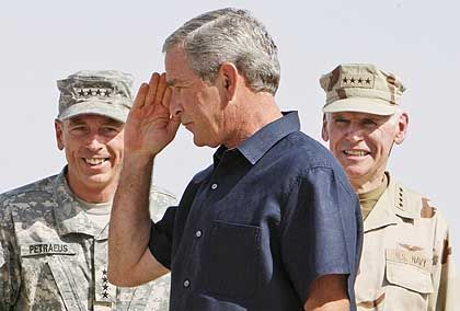 President Bush arrives at Al Asad Air Base in Anbar Province, Iraq, as Gen. David Petraeus, commanding general of the multinational forces in Iraq, looks on.