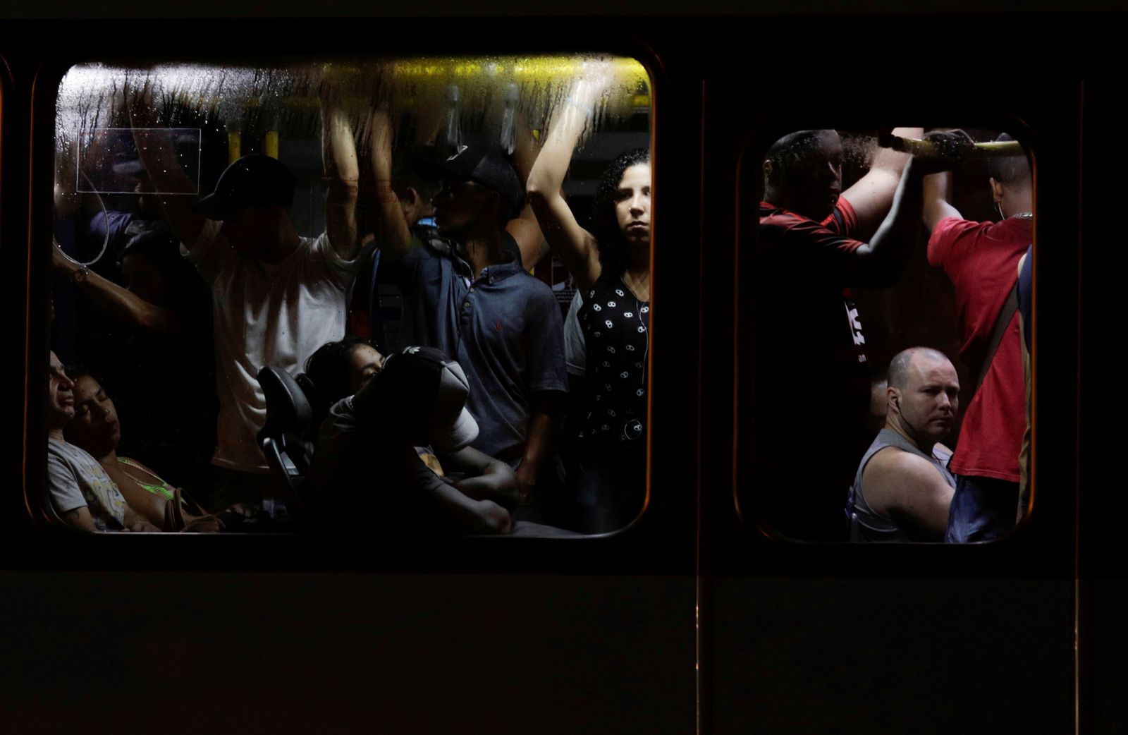 Passengers are pictured inside a public bus during the outbreak of the coronavirus disease (COVID-19) in Rio de Janeiro