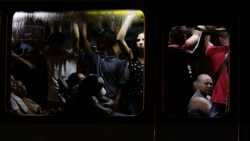 Commuters crowd into a bus in Rio de Janeiro during the coronavirus outbreak.