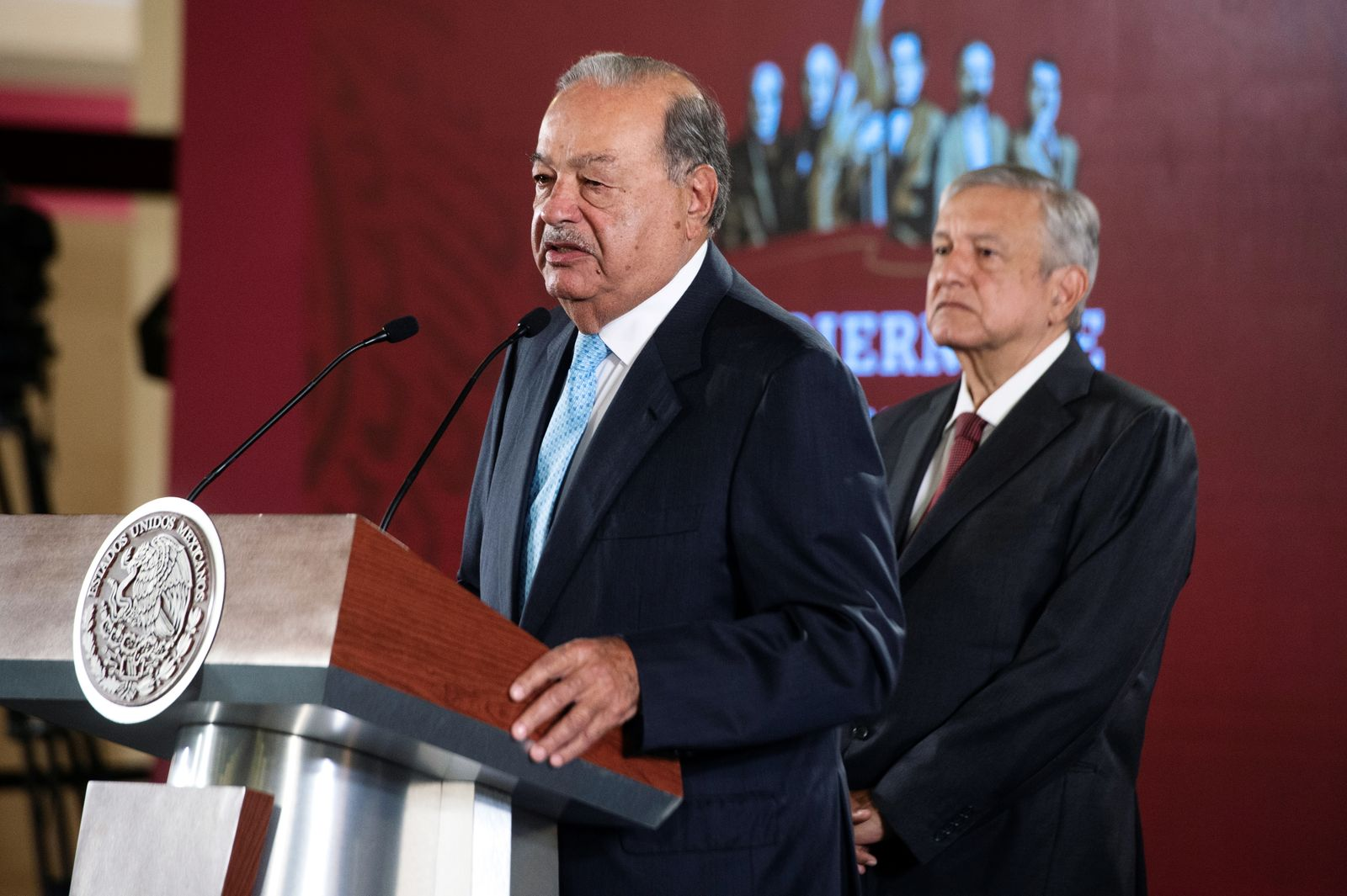 Mexican tycoon Carlos Slim speaks as Mexico's President Andres Manuel Lopez Obrador looks on during an event at National Palace in Mexico City