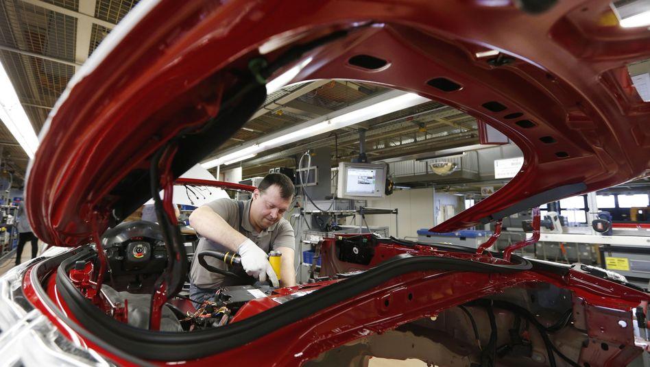 Wirtschaftswachstum erwartet: Mechaniker bei Porsche