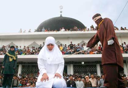 Shariah law is enforced in many parts of Indonesia. Here, a woman is publicly caned in Banda Aceh.