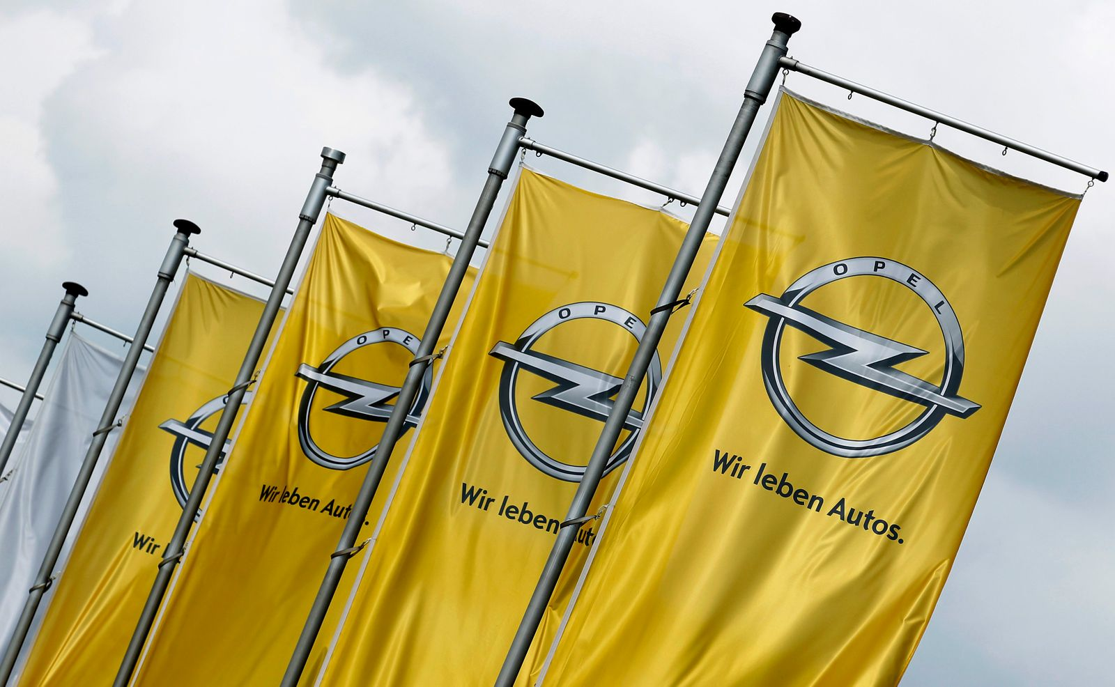 Flags of German car manufacturer Opel flutter in the wind outside headquarters in Ruesselsheim