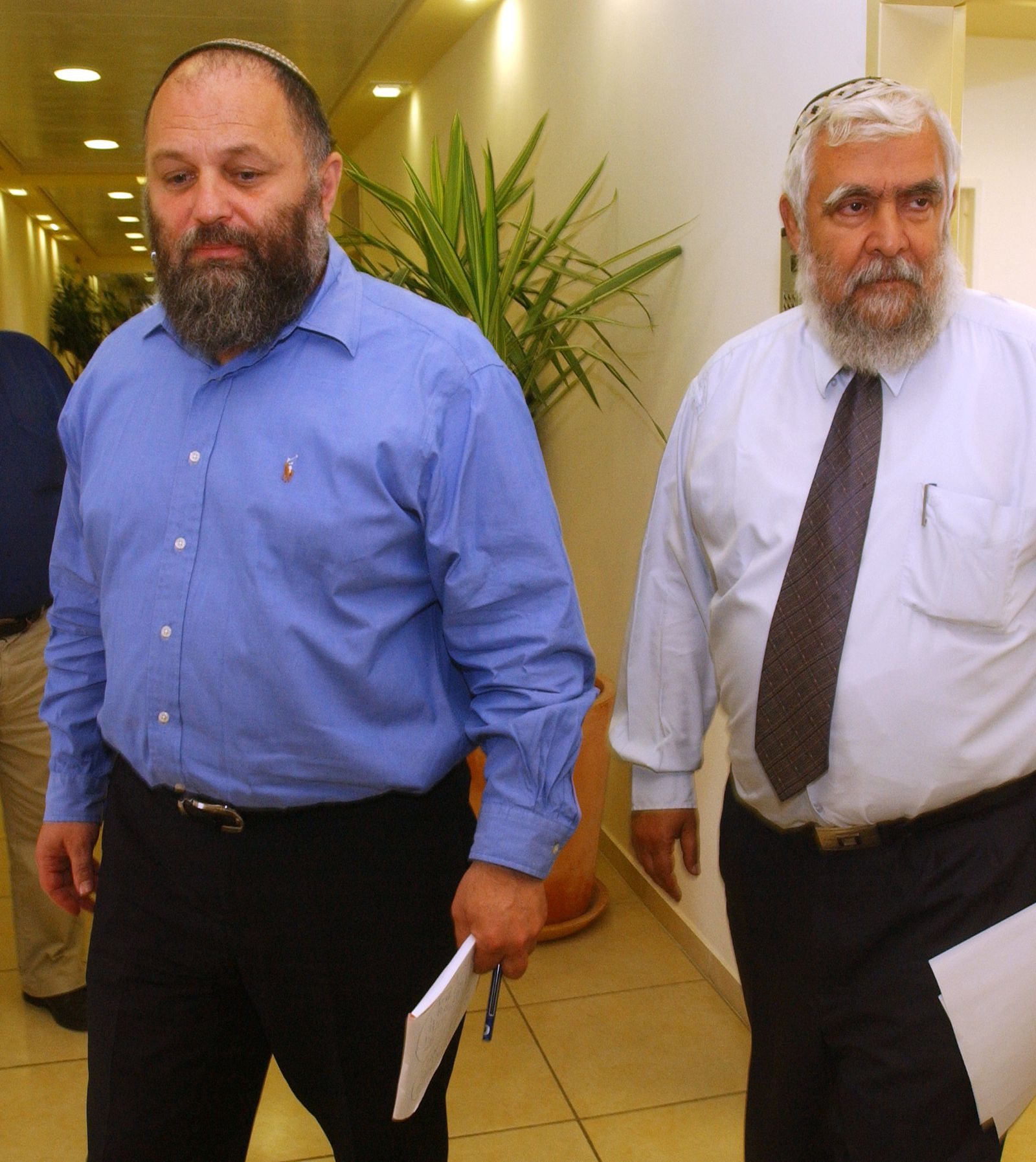 HOUSING MINISTER EFFI EITAM AND DEPUTY MINISTER YITZHAK LEVY LEAVE A PRESS CONFERENCE IN JERUSALEM.