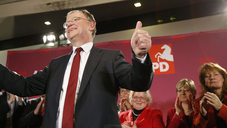Social Democrat and future governor of Lower Saxony Stephan Weil gives the thumbs up after his election victory on Sunday.