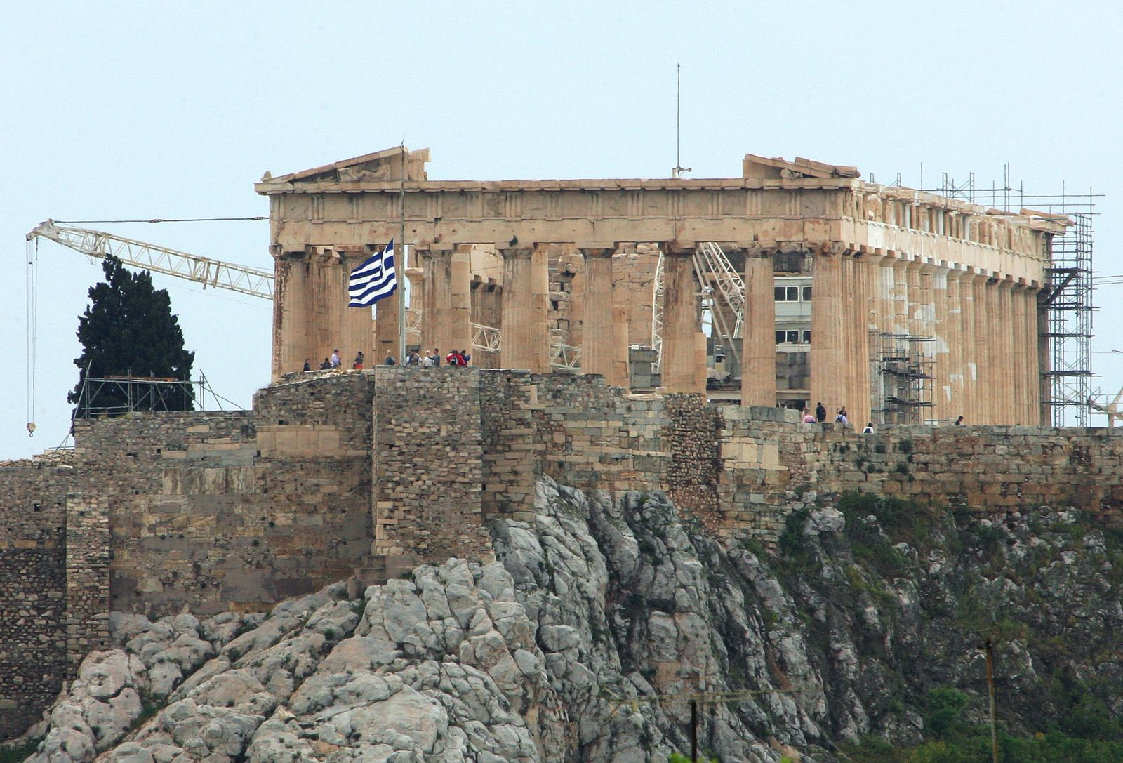 The Greek flag flies at half mast in fron of the Parthenon on the