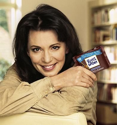 """""""Each bar of chocolate helps and you can help out too,"""" says German actress Iris Berben in a Ritter Sport ad."""