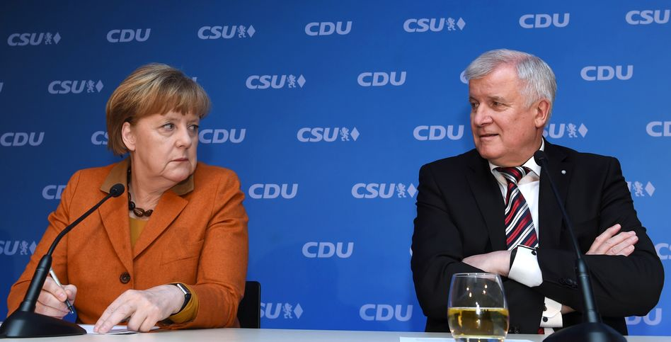 German Chancellor Angela Merkel and Bavarian Governor Horst Seehofer trying to look like they like each other on Monday.