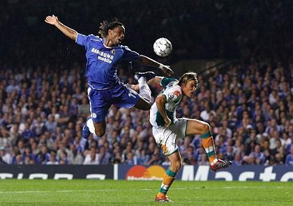 Chelsea's Didier Drogba flying high over German player Clemens Fritz. The English Premier League recieves more than four times the amount that the Bundesliga does from television rights.