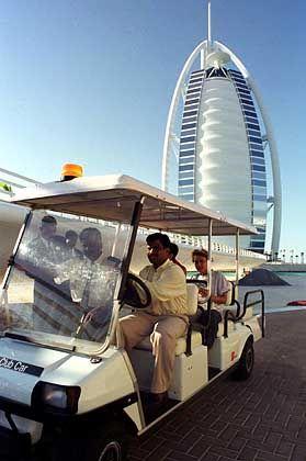 Guests arrive at the Burj al-Arab hotel in Dubai.