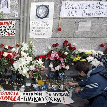 Flowers line the wall of the apartment building where journalist Anna Politkovskaya was murdered.