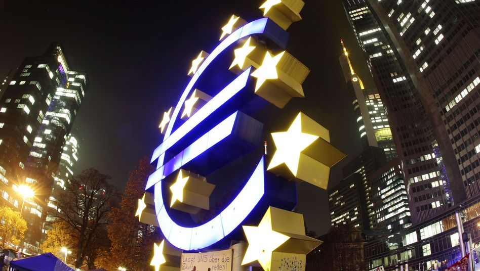 A Euro sculpture in front of the European Central Bank in Frankfurt, Germany.