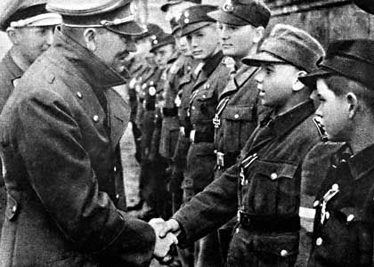 Hitler greets a member of the Hitler Youth. British double agent Eddie Chapman volunteered to assassinate the Führer in a suicide mission, new evidence reveals.