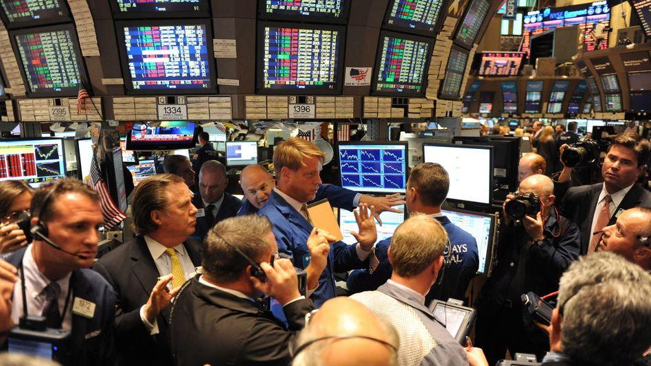 Börsenhändler in New York; Krisen-Gipfel sorgt für Zick-Zack-Kurs des Euro