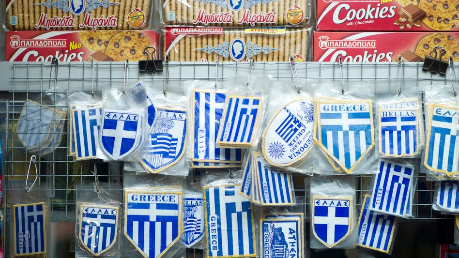 Greek flags for sale in a kiosk in Athens.