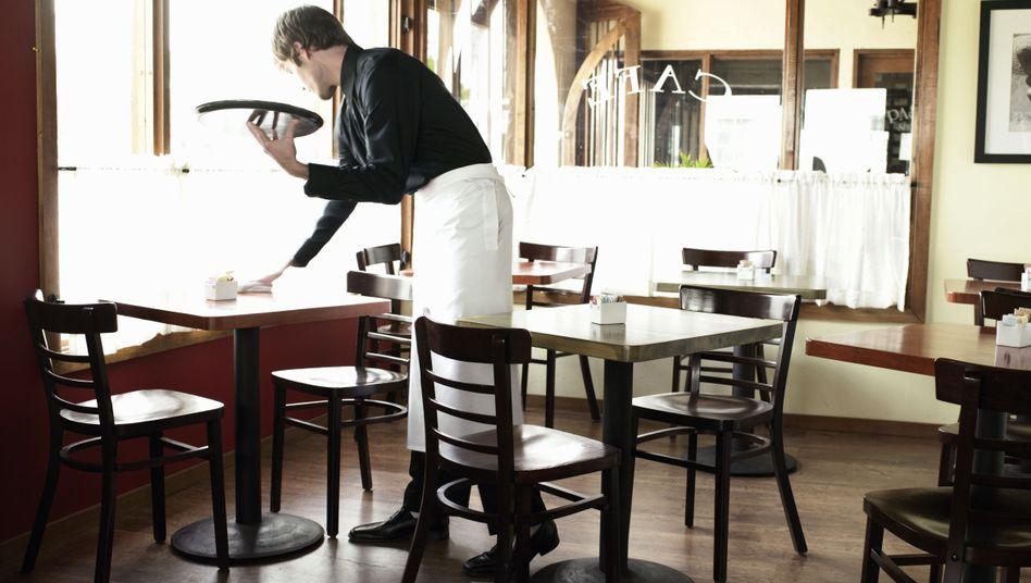 Er ist der Kellner, nicht der Koch im Restaurant