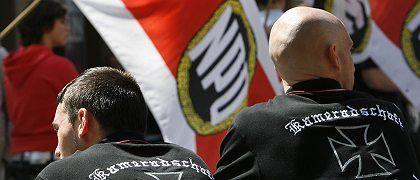 Right-wing extremists attend an NPD rally in May. Would a ban on the party help to stamp out racism in Germany?