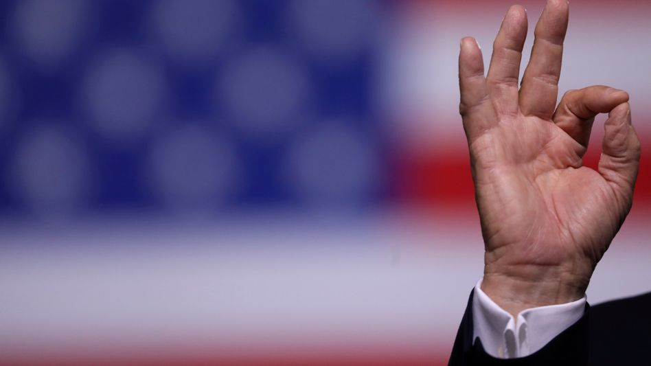 U.S. President Donald Trump gestures as he rallies with supporters in Manchester, New Hampshire.