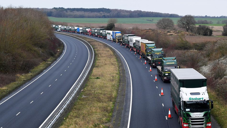 "A line of trucks participate in a trial run to test how Britain will cope with a ""no-deal"" Brexit scenario."