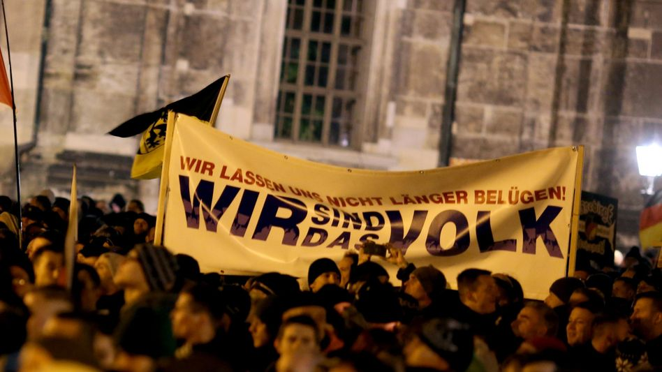 """""""We are the people."""" A sign at a 2014 Pegida protest in Dresden."""