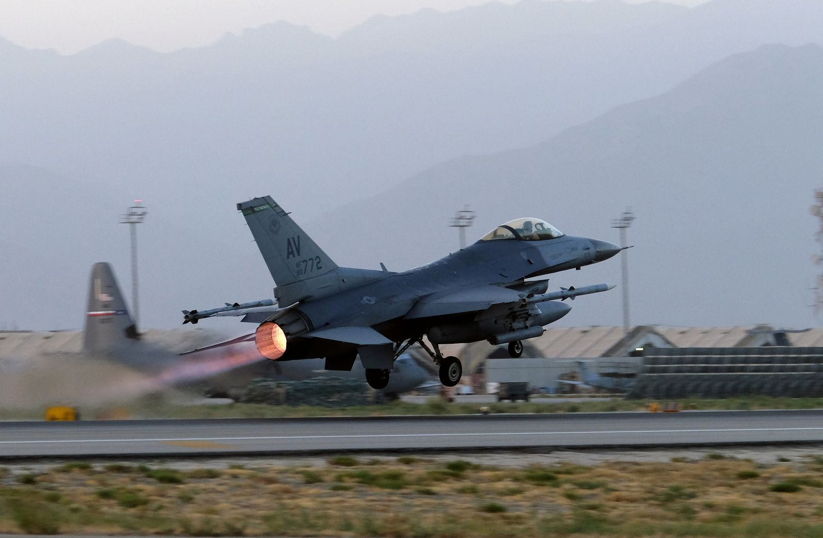 A U.S. Air Force F-16 Fighting Falcon aircraft takes off for a nighttime mission at Bagram Airfield