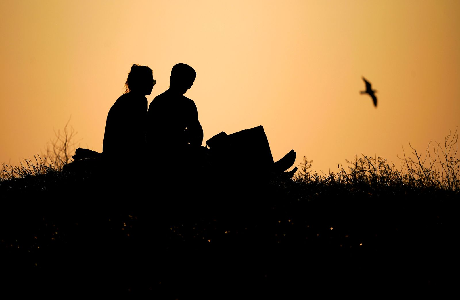 A couple enjoy the sunset in Malmo