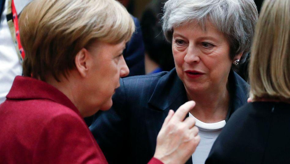 Angela Merkel und Theresa May in Brüssel
