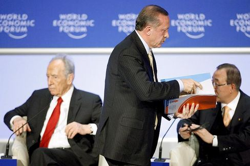 Recep Tayyip Erdogan (center), walks off the stage at Davos after an altercation with Israeli President Shimon Peres (left) at the World Economic Forum in Davos.