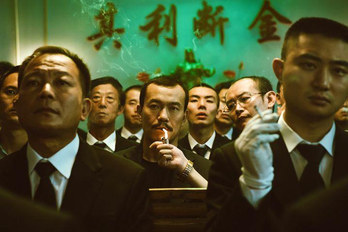 """Fan Liao (Mitte) in """"Asche ist reines Weiß"""""""