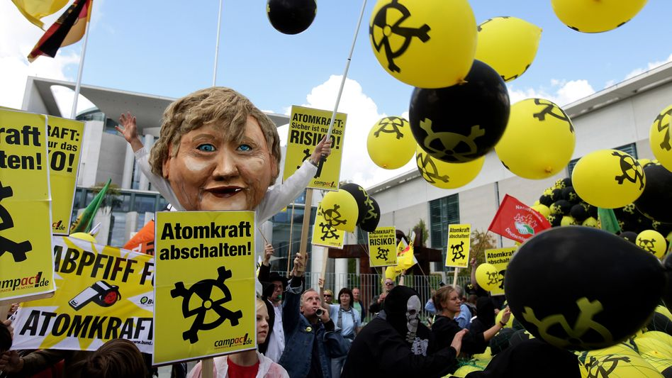 Anti-nuclear protesters demonstrate in front of the Chancellery in Berlin against the government's decision to postpone the lifespan of the country's atomic power plants.