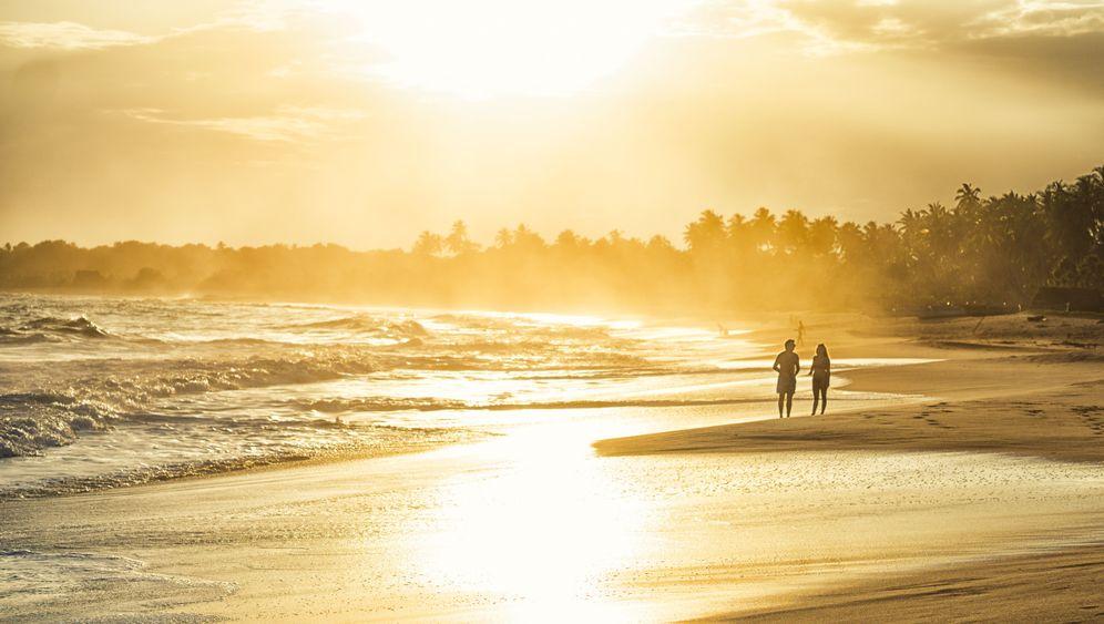 Die besten Leserfotos auf #SpOn_Reise: Fischerhütten, Surferglück und Palmenschaukel
