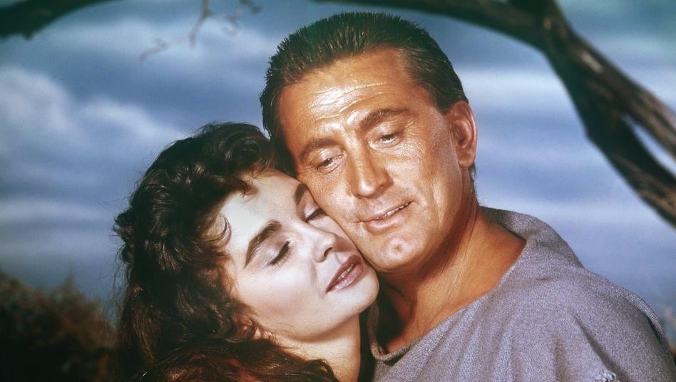 Diese Rolle machte ihn endgültig zur Kinoikone: Kirk Douglas als Spartacus im gleichnamigen Film über den Sklavenaufstand, hier zusammen mit Jean Simmons