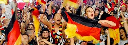 Fans in Berlin after the winning game against Poland: the country is vibrating, literally humming.