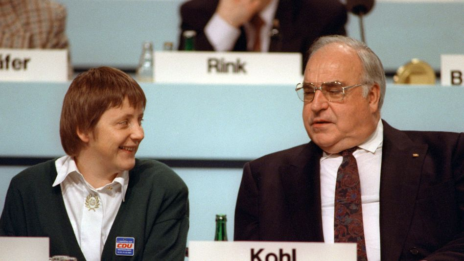 """Angela Merkel, then the German Women's Issues Minister, sits next to then-Chancellor Helmut Kohl in 1991: """"She has been turned."""""""