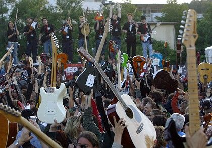 """Let there be rock: 1,800 guitarists play """"Smoke on the Water"""" in Germany to set a new world record."""